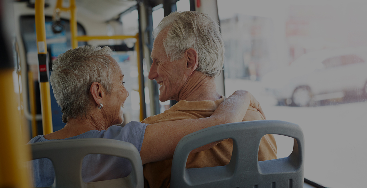 An older couple ride the bus to one of AdventHealth Cancer Institute's seven cancer care facilities in Central Florida