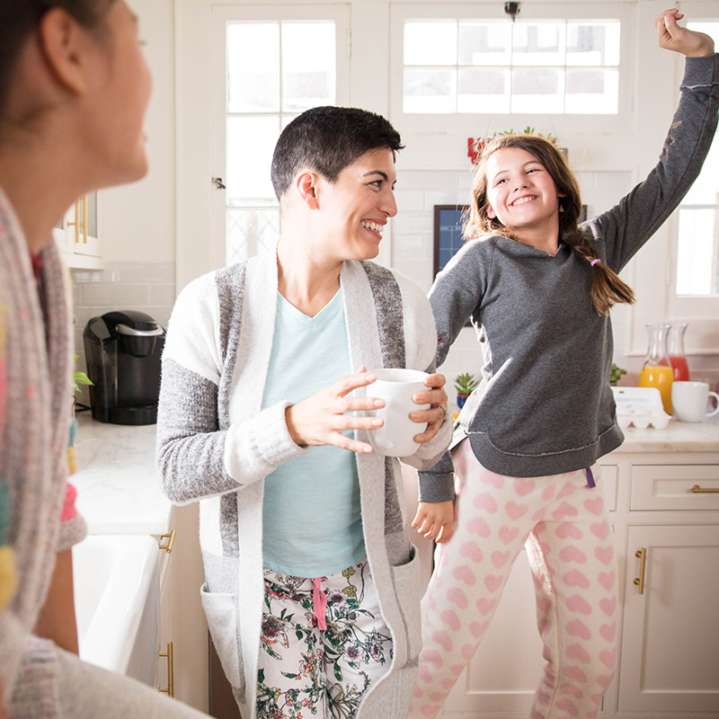 Family dancing in a kitchen