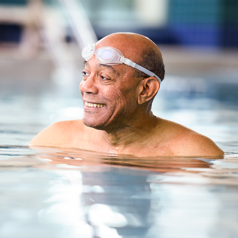 Elderly man in a swimming pool