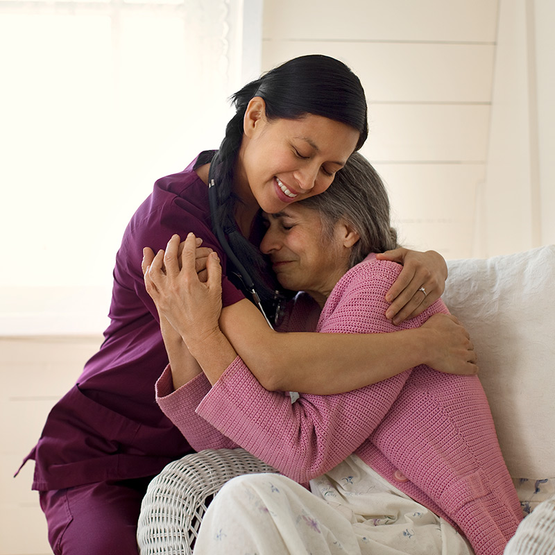 Female patient hugging a nurse