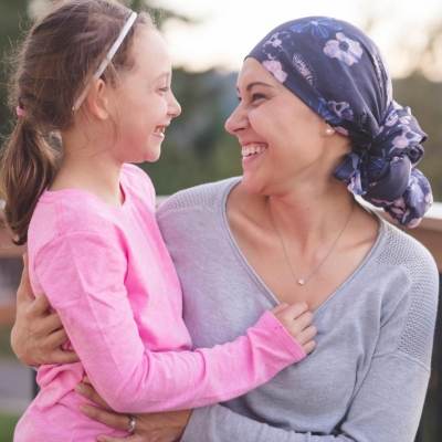Cancer survivor smiling with daughter